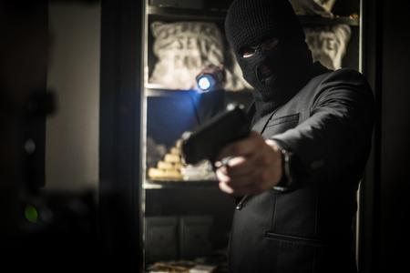 Ardmed man robbing a bank Stock Photo