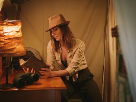Beautiful woman in a tent at savanna, Kenya