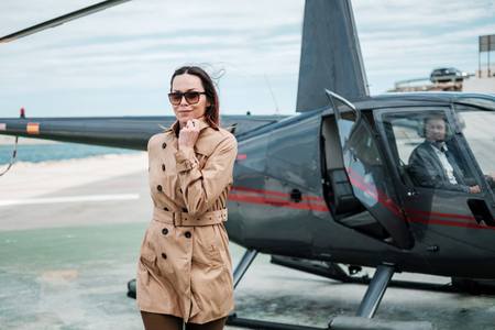 Business woman near private a helicopter