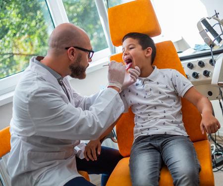 Boy at check-up at aryngologist