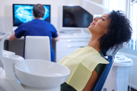 Man dentist works on a x-ray Stock Photo