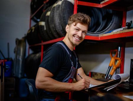 Mechanic choosing tires in a warehouse