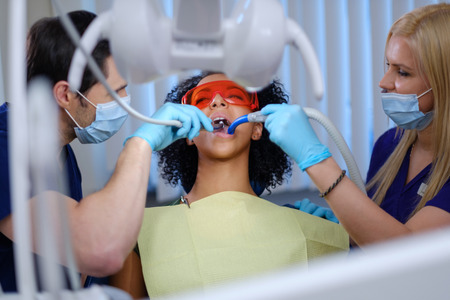 Dentist and his assitant working in private practice