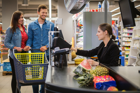 Young couple buying goods in a grocery store