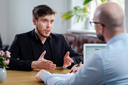 Confident young man attending job interview Zdjęcie Seryjne