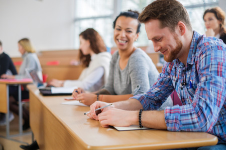 Multinational group of students in an auditorium Stock Photo