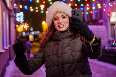 Woman making selfie a cold winter evening