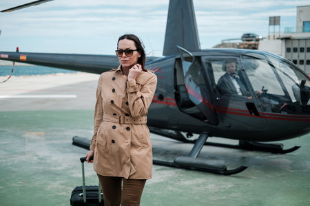Business woman near a private helicopter Stok Fotoğraf