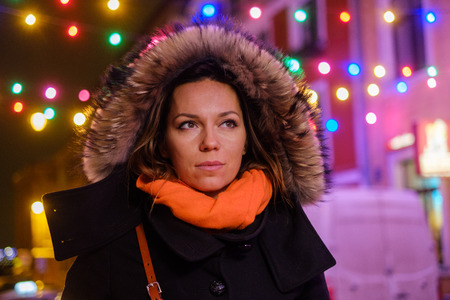 Woman outdoor on a cold winter evening