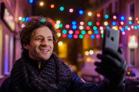 Man making selfie on a cold winter evening