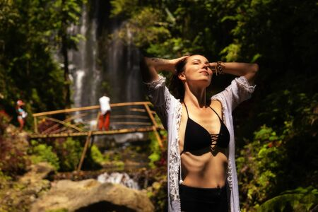 Woman near Labuhan Kebo Waterfall located in Munduk, Bali