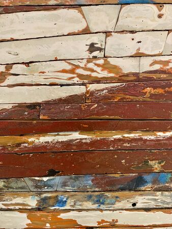 Colourful wooden planks wall texture.