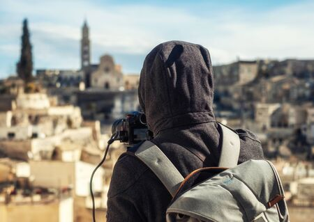 Photographer taking footage of beautiful Matera town, Italy