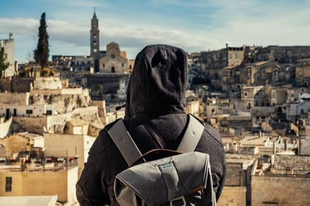 Photographer taking pictures of beautiful Matera town, Italy Banco de Imagens