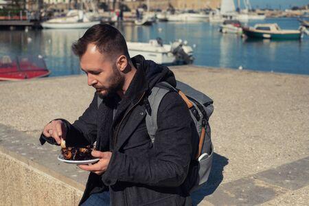 Man eating sea urchins caviar in Bari, Italy