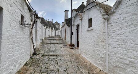 Walking streets of trulli town Alberobello, Italy