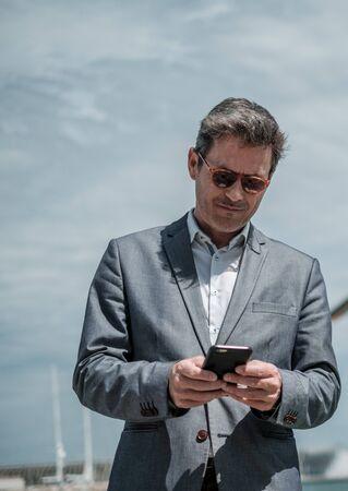 Businessman with a phone on an airfield Zdjęcie Seryjne