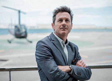 Businessman standing near an airfield