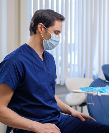 Doctor wearing protective mask in a hospital