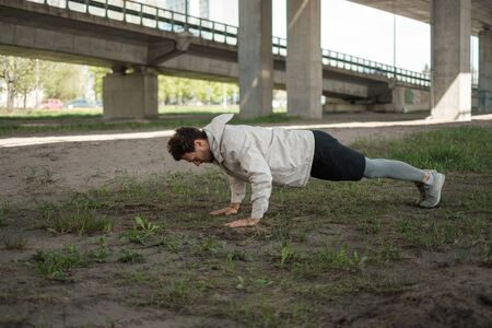 Man doing push-ups during street workout