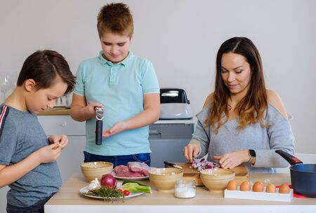 Happy family cooking togehter at home