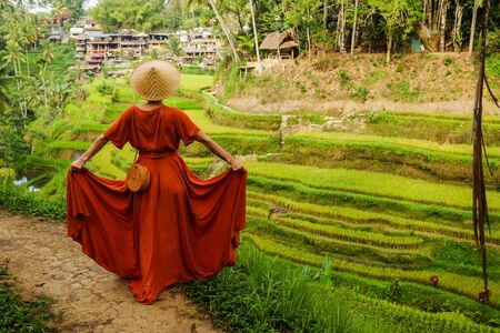 Woman walking on Tegalalang Rice Terrace, Bali.
