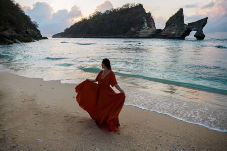 Woman at Atuh beach at Nusa Penida Island, Bali, Indonesia.