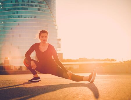 Body positive woman doing fitness exercise outdoor