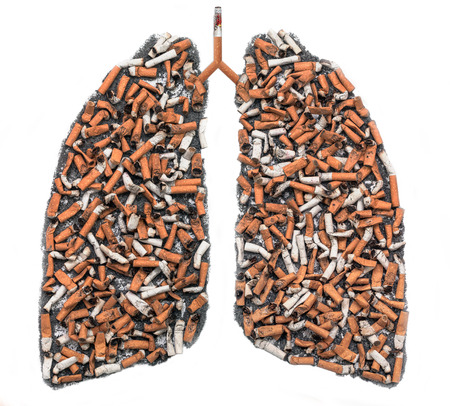 Cigarette butts and ash in the form of pulmonary contour on white background, as a symbol of the campaign against smoking