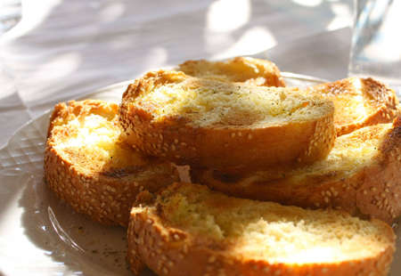 Fresh toasted bread with olive oil and sesame in the greek taverna Stock Photo