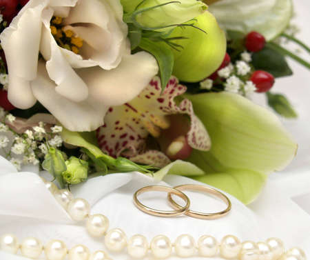 Wedding rings and flowers photo