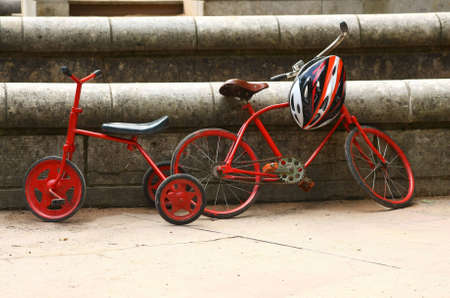 Two red retro bicycles and modern helmet Stock Photo