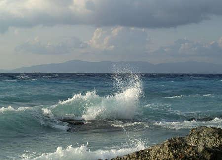 Wave breaking against stones