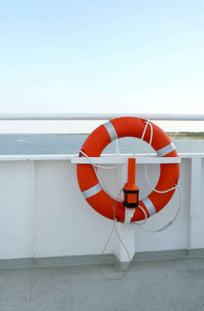 Lifebuoy on deck of the cruise ship Stock Photo