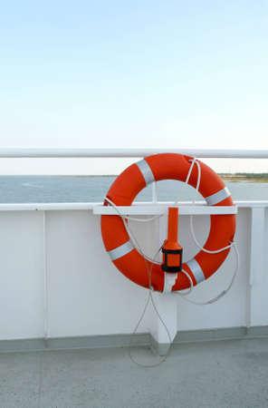 Lifebuoy on deck of the cruise ship Stock Photo