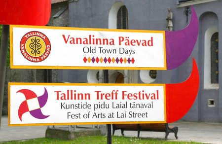 Tallinn, Estonia - June 6, 2010: Billboard on the background of the church. 29th Tallinn Old Town Days