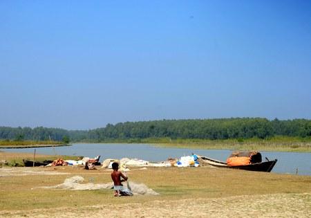 holed: Fisherman Mesh fabric near river