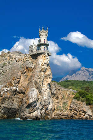 Swallow's NestÊis a mock-medieval castle near Yalta, in Crimea, Ukraine. It was built between 1911Ð1912, on top of 40-meter (130Êft) high Aurora Cliff, to a New-Gothic design by the Russian architect Sherwood.ÊThe castle overlooks cape of the Black Sea.ÊS