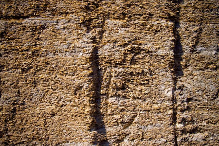 caked: Cracked clay wall