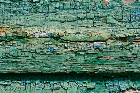 Wooden boards with cracked paint