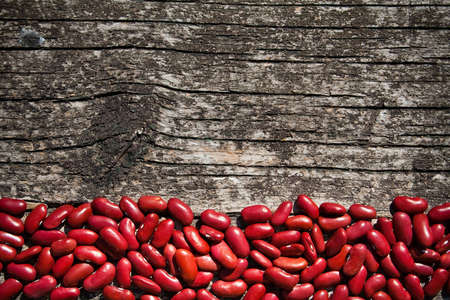 red beans on a wooden board Stock Photo