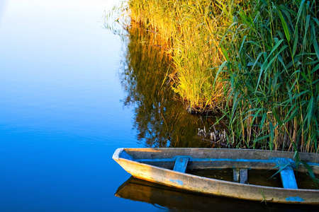 lone boat on calm water