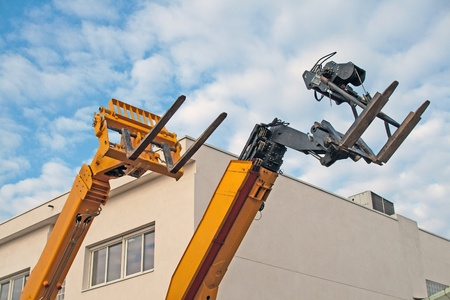 Lift trucks, fenwicks, on blue sky, waiting to be used Stock Photo - 9023079