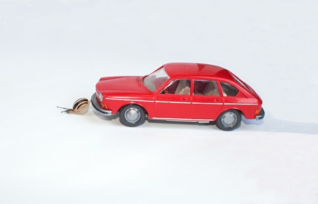 towing of a car by a small snail determined photo