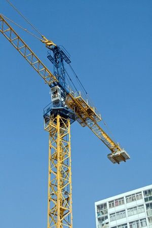 crane in action on a blue sky and building Stock Photo - 9319753