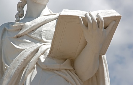 woman reading:  17th statue representing a woman who reads Stock Photo