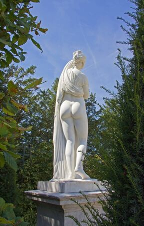 female nudity: Female nudity behind a grove (statue of 17th) Stock Photo