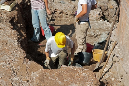 scientists conducting archaeological excavations on an ancient site in Rome Italy