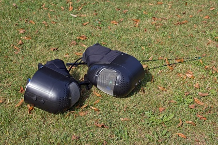 fencing equipment placed on the ground during a sporting event photo
