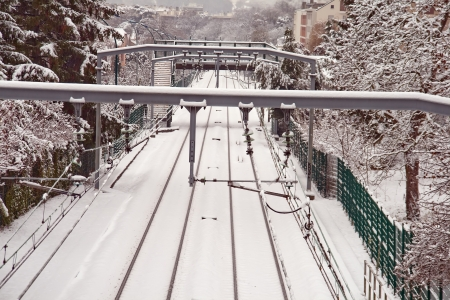 catena: station in the Paris suburbs in the snow in winter Stock Photo